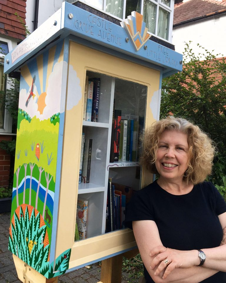 Teresa Flavin with the Free Little Library she painted in 2021
